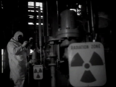 1950s montage man in radiation suit examining a reactor / hanford, washington, united states - radiation stock videos & royalty-free footage