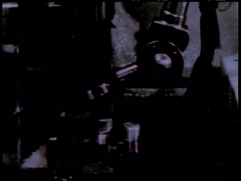 1950s montage man operating a mechanical hand used for handling nuclear material / united states - nuclear reactor stock videos and b-roll footage