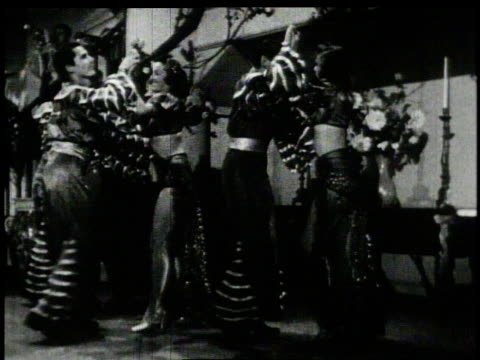 1950s montage men and women dancing in ethnic costumes - salsa stock videos & royalty-free footage
