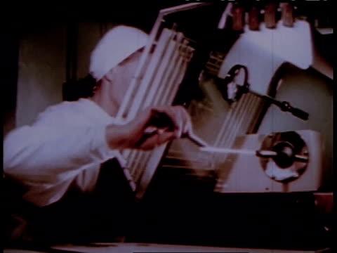 vidéos et rushes de 1950s montage nurse prepares surgical instruments / russia - ex urss