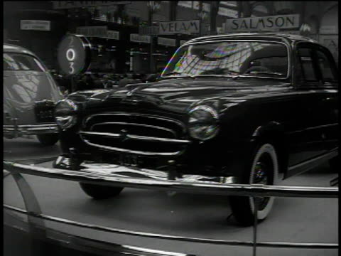 stockvideo's en b-roll-footage met 1950s montage people attending auto show / france - 1955