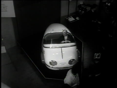 1950s montage people examining cars at auto show / france - frankreich stock-videos und b-roll-filmmaterial