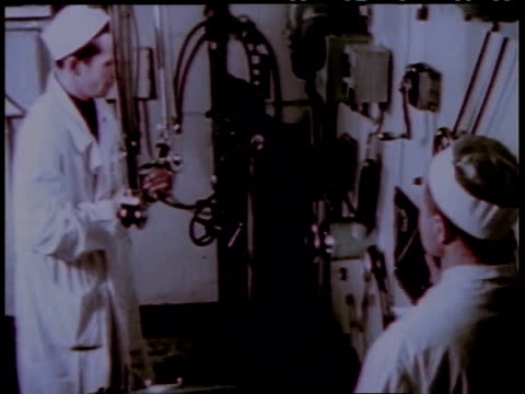 1950s montage scientist working with nuclear materials with a remote control from another room / united states - nuclear reactor stock videos and b-roll footage