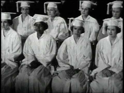 1950s montage students listening to a commencement speech at a graduation ceremony/ united states - uguaglianza video stock e b–roll