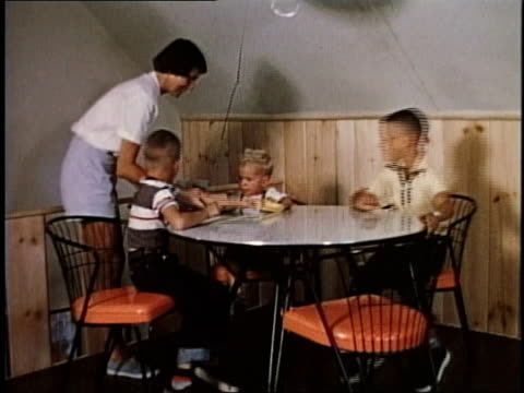 1950s montage woman bringing beverages to children sitting at a table / levittown, pennsylvania, united states - levittown pennsylvania stock videos and b-roll footage