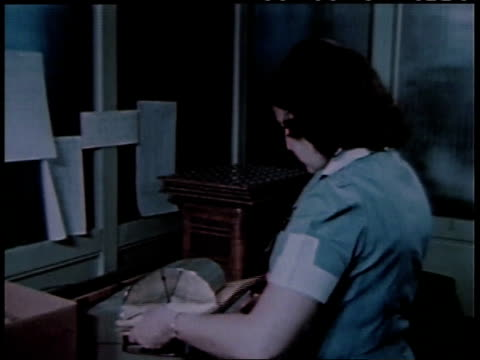 1950s montage woman sorting letters / united states - post structure stock videos & royalty-free footage