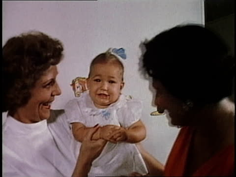 1950s montage women holding smiling baby at daycare / levittown, pennsylvania, united states - levittown pennsylvania stock videos and b-roll footage