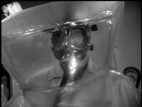 1950s montage worker in an inflated plastic bubble / hanford, washington, united states - inflatable stock videos & royalty-free footage