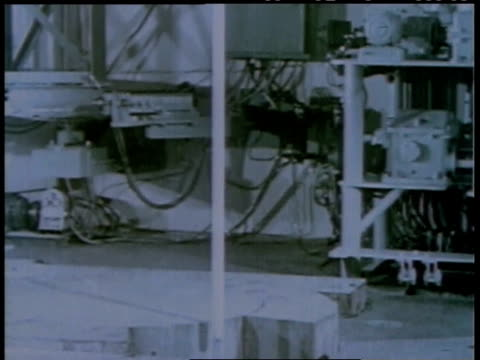 1950s montage worker transporting nuclear materials with a remote control / united states - nuclear reactor stock videos & royalty-free footage