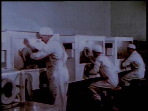 1950s montage workers at a nuclear reactor handling radioactive isotopes / united states - nuclear power station stock videos & royalty-free footage