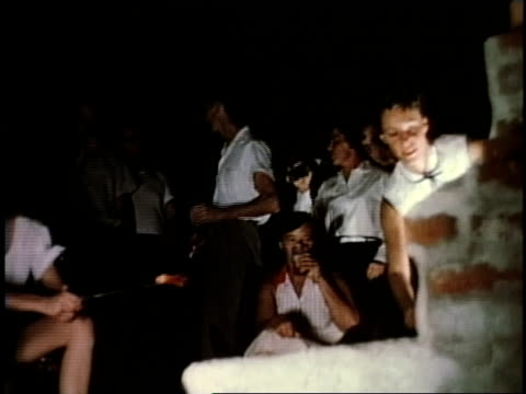 1950s montage young women relaxing around a campfire, roasting meat / levittown, pennsylvania, united states - levittown pennsylvania stock videos and b-roll footage