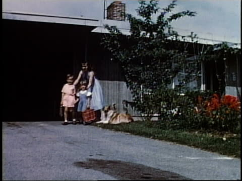 1950s ts mother waving to children as they are walking down the driveway / levittown, pennsylvania, united states - levittown pennsylvania stock videos and b-roll footage