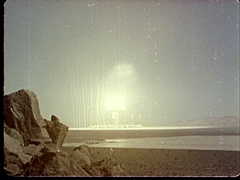 1950s mushroom cloud forming after explosion in desert at camp desert rock at nevada test site / nye county, nevada, usa - nevada stock videos & royalty-free footage
