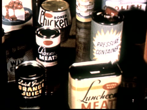 1950s cu ha pan over display of various canned foods - canned food stock videos & royalty-free footage