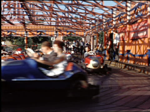 1950s people driving bumper cars on amusement park ride / wurstelprater amusement park, prater park / vienna, austria - prater park stock videos & royalty-free footage