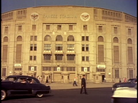 1950s WS Policeman directing traffic outside Yankee Stadium / New York, New York, USA