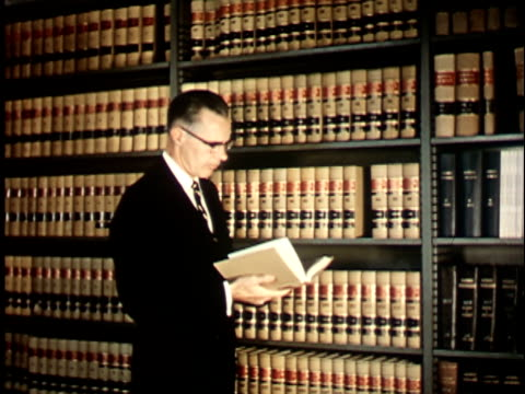1950s ms, professor reading book in library at berkeley university, 1950's, california, usa - wisdom stock videos & royalty-free footage