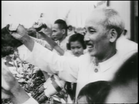 b/w 1950s profile ho chi minh smiling waving outdoors / north vietnam / newsreel - north vietnam stock videos and b-roll footage