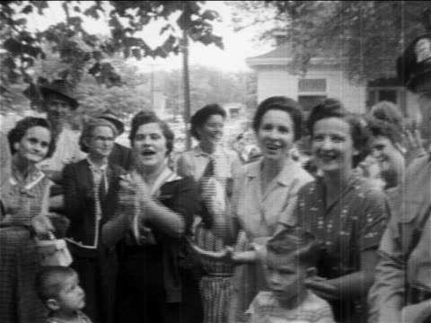 b/w 1950s prosegregation women protesting clapping outside of segreated school / newsreel - demonstrant stock-videos und b-roll-filmmaterial
