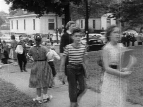 1950s pro-segregation women protestors walking with children on sidewalk / newsreel - dominering bildbanksvideor och videomaterial från bakom kulisserna