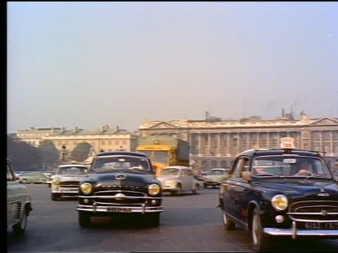 1950s rear car point of view in traffic in Place de la Concorde / Paris, France