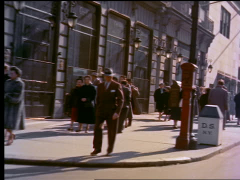 1950s rear side car point of view people walking on 5th avenue sidewalk in new york city in winter - fifth avenue stock videos and b-roll footage