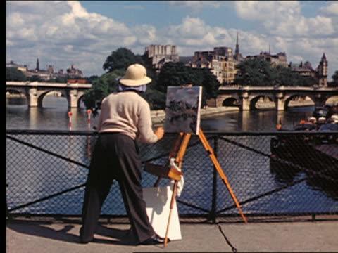 1950s rear view man painting seine river, ile de la cite + pont-neuf on canvas on easel / paris - painter artist stock videos and b-roll footage