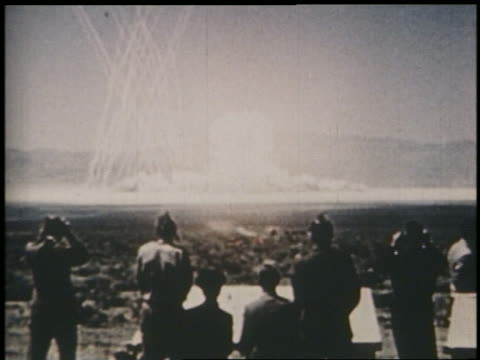 1950s rear view people watching hydrogen bomb explosion / nevada / newsreel - weapons of mass destruction stock videos & royalty-free footage