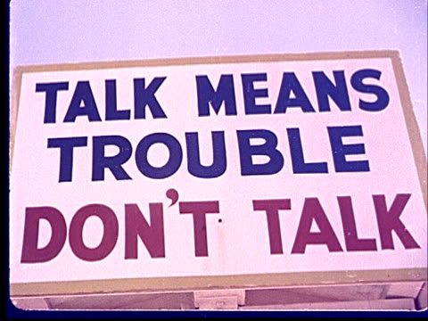 1950s CU LA Sign reading 'Talk Means Trouble Don't Talk' at Camp Desert Rock at Nevada Test Site / Nye County Nevada USA