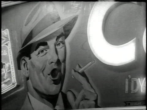 1950s cu smoke coming out of man's mouth on cigarette billboard / new york city, new york, united states - sigaretta video stock e b–roll