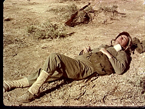 1950s soldier lying on his back sleeping in desert / rifle lying in sagebrush beside soldier at camp desert rock at nevada test site / nye county... - lying on back stock videos & royalty-free footage