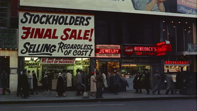 1950s WS PAN Street scene with store signs, Times Square, New York, New York State, USA