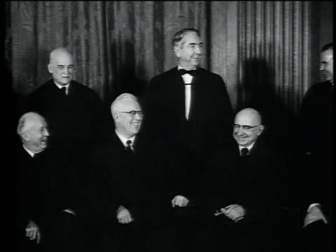 1950s PAN Supreme Court judges William O Douglas Earl Warren Hugo Black and Felix Frankfurter and others posing for picture / Washington DC United...