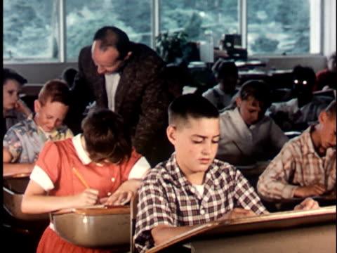 1950s MS, PAN, Teacher and children (12-13) in classroom, Berkeley, California, USA