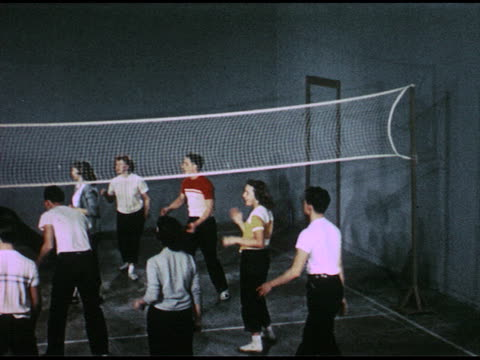 1950s teens playing indoor volleyball/ similar shot above net/ close shot of someone holding volleyball/ illustrated card with volleyball reads be... - volleyball net stock videos & royalty-free footage