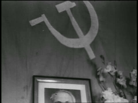 b/w 1950s tilt down from soviet flag to framed photograph of ho chi minh on wall / newsreel - former ussr flag stock videos & royalty-free footage