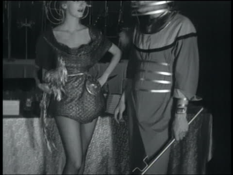 vidéos et rushes de b/w 1950s tilt up from feet to heads of couple in futuristic fashion at party - pied humain