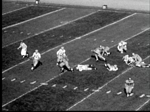 """""""1950s ha ws pan touchdown being scored at university of colorado at boulder football game/  boulder, colorado"""" - boulder stock-videos und b-roll-filmmaterial"""