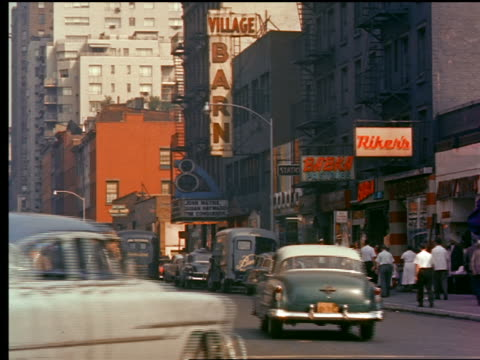 1950s traffic turning onto street in greenwich village / new york city - greenwich village stock videos & royalty-free footage