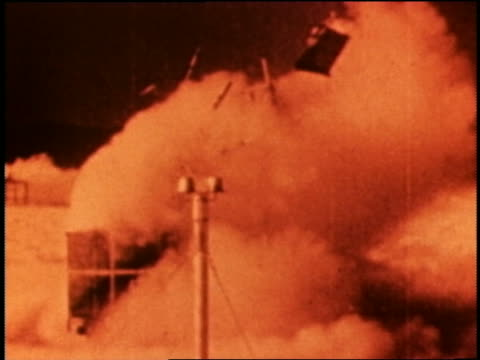 ORANGE 1950s water tower blown away by hydrogen bomb explosion / Nevada? / newsreel