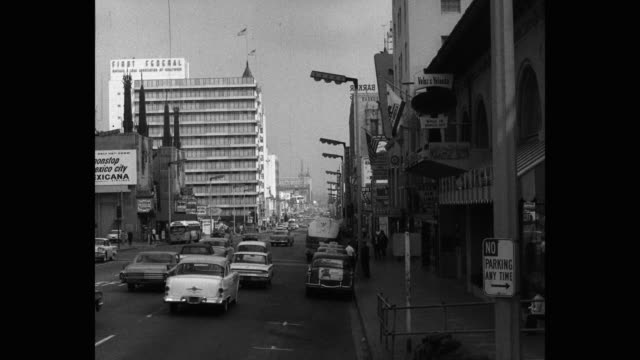 1950s - wide shot of traffic moving on street in city, los angeles, california, usa - no parking sign stock videos & royalty-free footage
