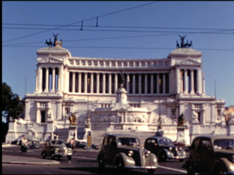 1950s wide shot Vittorio Emanuele Monument (Altar of the Nation) with traffic in front / Piazza Venezia, Rome