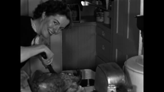 1950s woman carving thanksgiving turkey home movie - roast turkey stock videos & royalty-free footage
