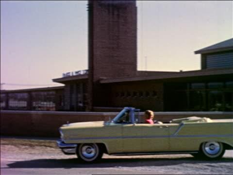 1950s pan woman driving yellow convertible lincoln pulls up to school bldg, waving, boy runs to car - family convertible stock videos & royalty-free footage