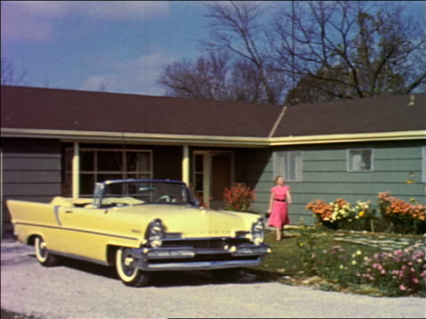 1950s woman walking from house to yellow convertible lincoln parked in driveway / industrial - ford motor company stock videos and b-roll footage