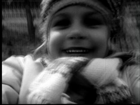 """1950s cu pov young girl smiling as she swings on swing/ st. louis, missouri"" - woolly hat stock videos and b-roll footage"