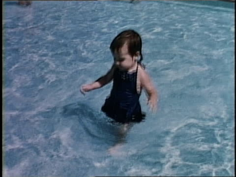 1950s young girl wading in pool / levittown, pennsylvania, united states - levittown pennsylvania stock videos and b-roll footage