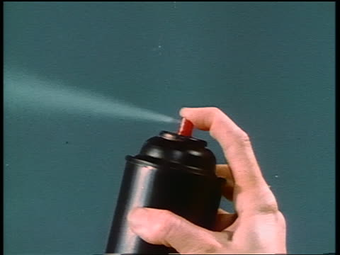 1950s/60s close up woman's hand spraying aerosol can (insecticide) - b roll stock videos & royalty-free footage