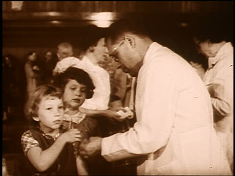 b/w sepia 1950s/60s doctor giving polio vaccine to young girl indoors - sepia stock videos and b-roll footage