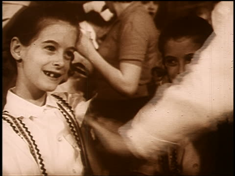 B/W SEPIA 1950s/60s doctor's hand giving polio vaccine to smiling girl next to twin with missing teeth